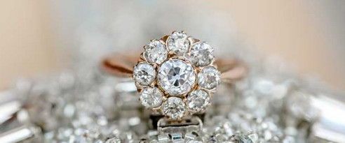 A circular diamond on a rose gold band in Swartz Creek, MI, engagement rings